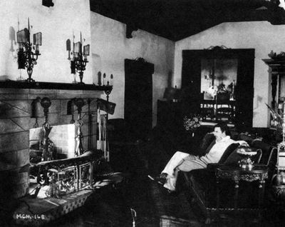 John Gilbert relaxing at him home in the Hollywood hills.